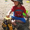 Jaden digging with his tractor