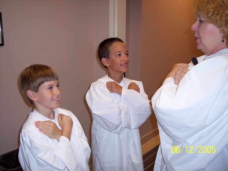 Michael (middle) preparing to be baptized.
