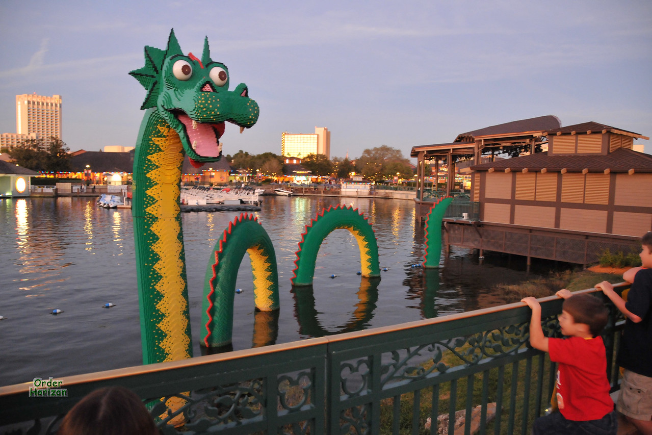 Boys admire the giant Lego serpent at Downtown Disney
