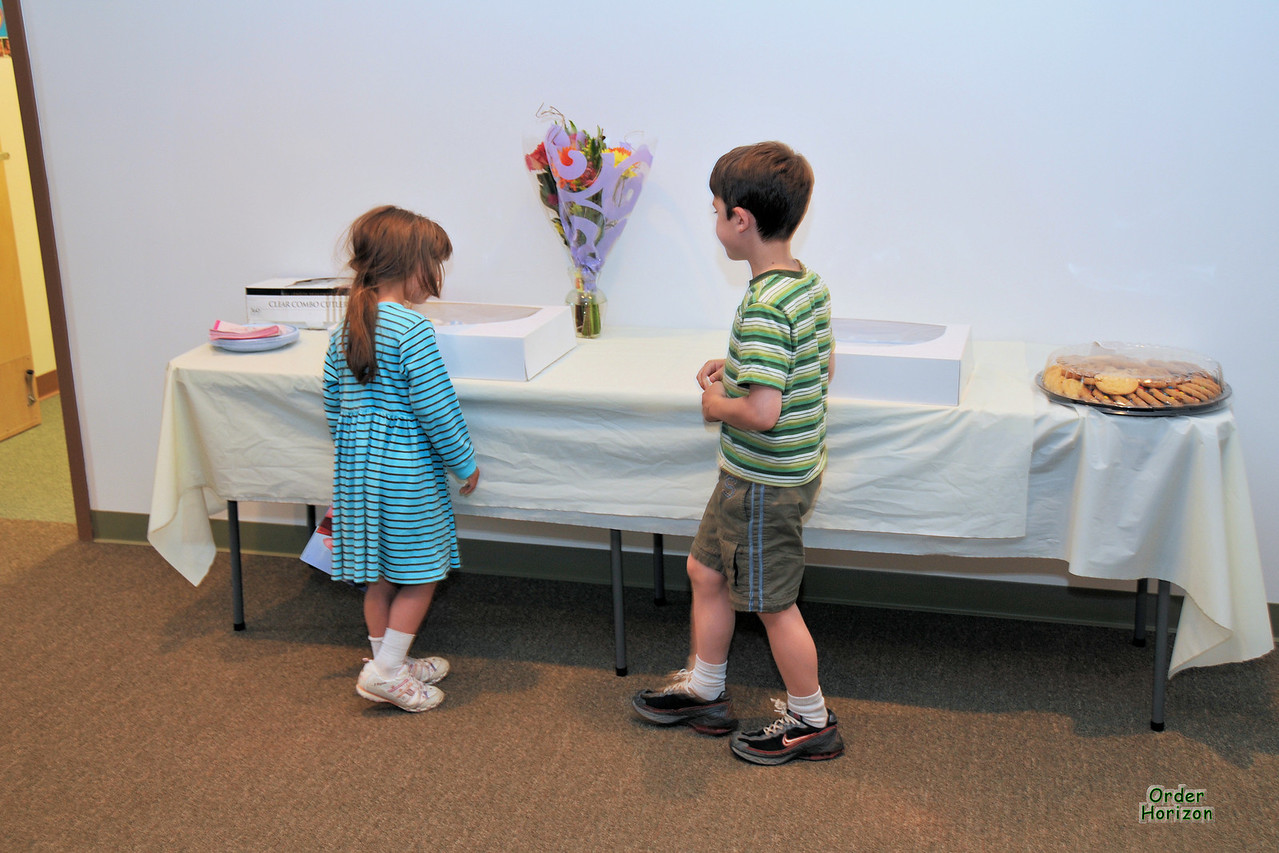 Alice and Charles are first to the treat table after the recital.