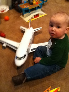 Theo playing with an airplane at Sawyer's house