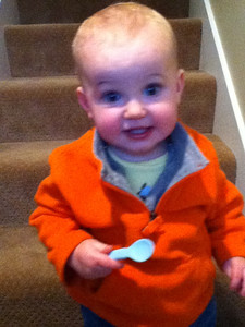 Theo at the bottom of the stairs very pleased with himself