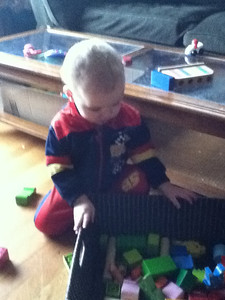 Playing with blocks at home in his new Cars track suit