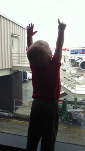 Super short (accidental filming) of Theo watching planes at the airport
