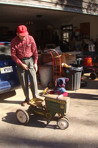 Theo saw a tractor in a display during services and couldn't stand not getting on it. Granddaddy procured one that afternoon for him to ride.