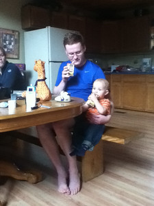 Daddy and Theo drinking from juice boxes together