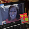 Awkward moment as it is now Kelly's turn to open her Thankmas gift.  Sadly, she's only 2 dimensional on Skype.  Megan had to assist.  Funny moment!