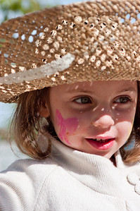 """Clementine Huck enjoying a self decorated hat at the University City Children's Center """"Eggstravaganza"""""""