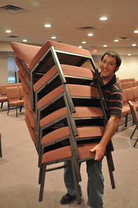 How many chairs can Adam lift??