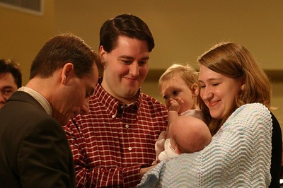 This is our growing family as we commit to teaching William about Christ.  He smiled at us the whole time.