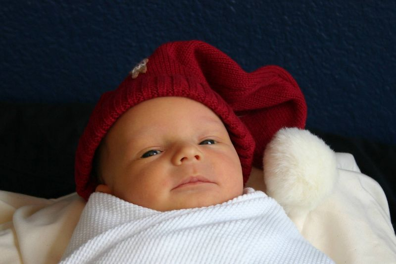 Santa baby!  William cuddles up for a Christmas picture.  He's almost a little too cozy.  I see those eyes drifting!