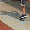 July 21, 2021 -- Tyler Lefebvre, 7, of Wilmington, plays hopscotch at the pavilion at Yentile Farm Recreational Facility in Wilmington.  SUN/Julia Malakie