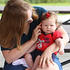 July 21, 2021 -- Michelle Kelsey and her daughter Piper, 5 months old, of Wakefield, sit in the pavilion at Yentile Farm Recreational Facility in Wilmington.  SUN/Julia Malakie