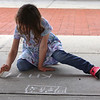 July 21, 2021 -- Kate Lefebvre, 5, of Wilmington, does chalk drawings in the pavilion at Yentile Farm Recreational Facility in Wilmington.  SUN/Julia Malakie