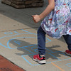 July 21, 2021 -- Kate Lefebvre, 5, of Wilmington, plays hopscotch at the pavilion at Yentile Farm Recreational Facility in Wilmington.  SUN/Julia Malakie