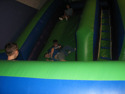 Tyler and Zack rolling down the slide.