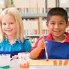 Kindergarten children painting