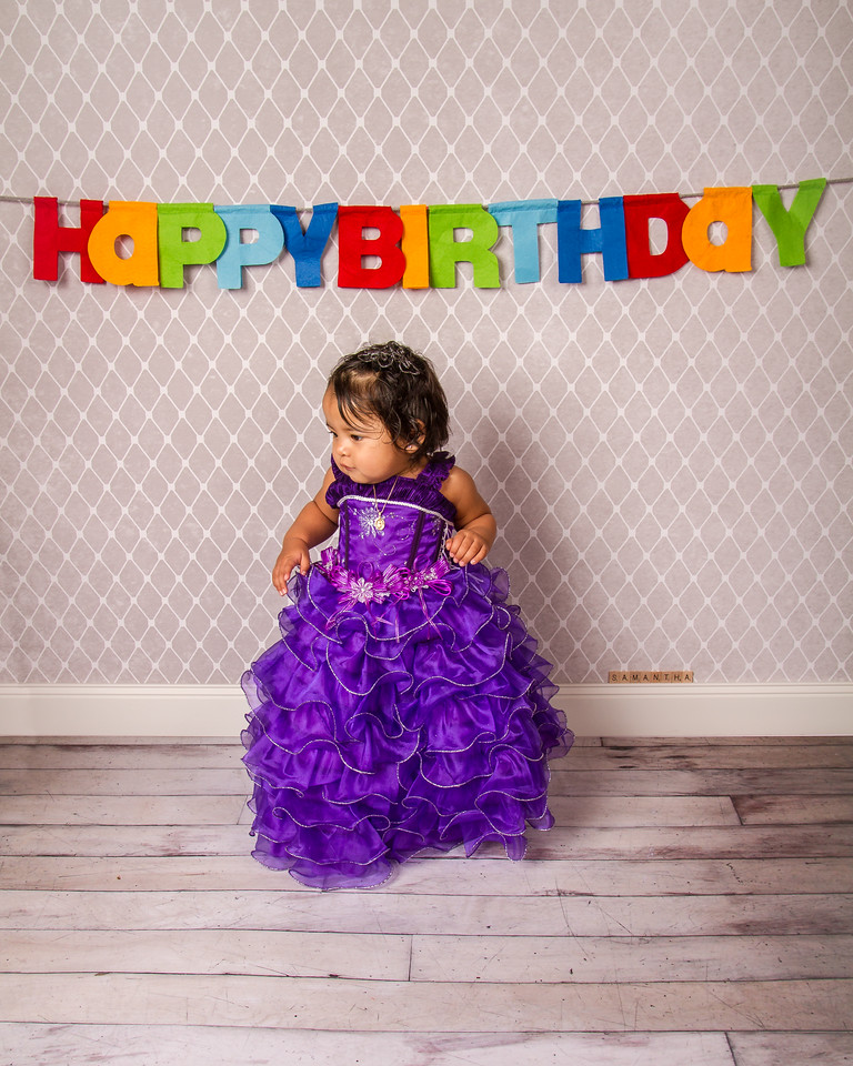We had yet another opportunity to capture little Samantha. This time it was to celebrate her first birthday! Such a cutie!  Here's a sneak peek of our session; more photos coming soon!
