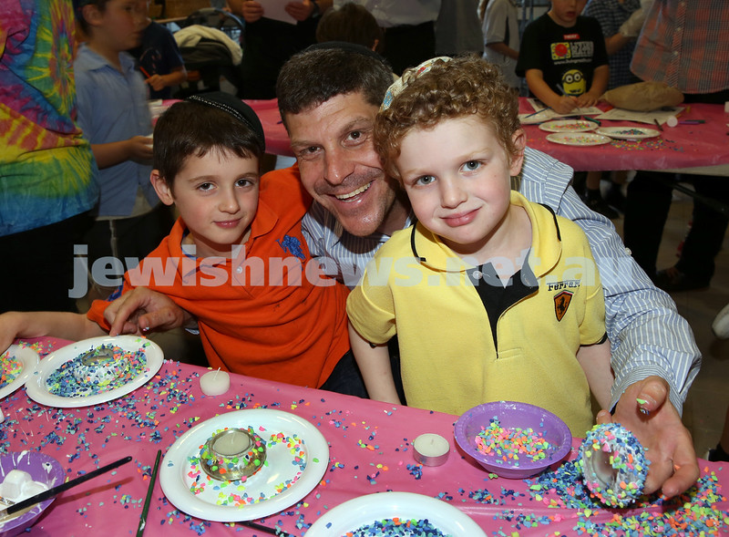 Childrens Challa Bake for The Shabbat Project held at OBK in conjunction with JEMS which attracted over 50 children. Aiden and Jonjon Suntup with their dad Lance, decorate candle holders for their mum Lauren.