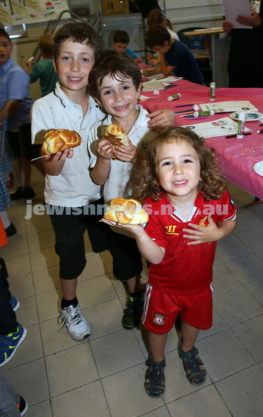 Childrens Challa Bake for The Shabbat Project held at OBK in conjunction with JEMS which attracted over 50 children. Brothers Jake (back) Daniel (M), Ezra (F) Newfield show off their challahs.