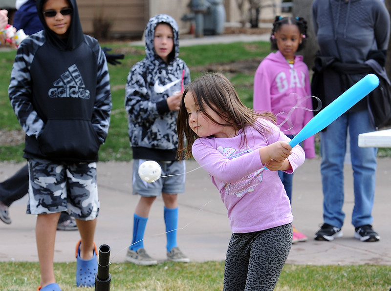 Ella Bebo, 5, hits the ball while trying out T-ball Monday, April 18, 2016, during Children's Day activities at the Civic Center in Loveland. (Photo by Jenny Sparks/Loveland Reporter-Herald)