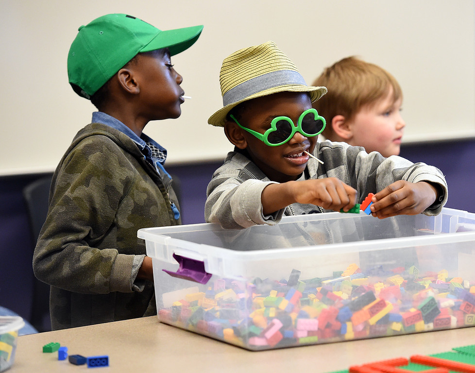 . Adelza Adebayo, 4, center, and his brother, Onimis Adebayo, 6, left, play with Legos Friday, March 9, 2018, during Children\'s Day at the Chilson Recreation Center in dowtown Loveland.  (Photo by Jenny Sparks/Loveland Reporter-Herald)