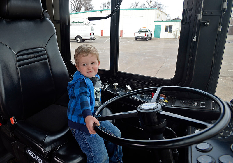 Oliver Leddy of Loveland, 22 months, pretends to drive a City of Loveland Transit bus Friday, March 9, 2018, during Children's Day at the Loveland Traffic Operations Center in dowtown Loveland.  (Photo by Jenny Sparks/Loveland Reporter-Herald)
