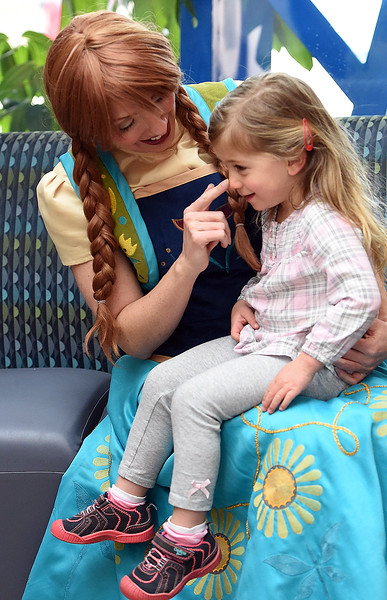Josie Dayhuff, 2, sits on the lap of Anna from Disney's Frozen Friday, March 9, 2018, during Children's Day at the Chilson Recreation Center in dowtown Loveland.  (Photo by Jenny Sparks/Loveland Reporter-Herald)