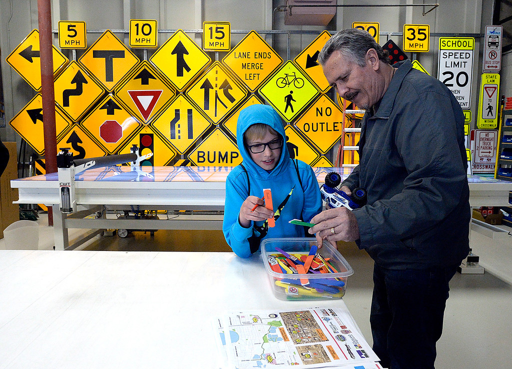 . Justin Boxterman, 9, checks out bookmarks with his grandpa, Bob Angelovic Friday, March 9, 2018, during Children\'s Day at the Loveland Traffic Operations Center in dowtown Loveland.  (Photo by Jenny Sparks/Loveland Reporter-Herald)
