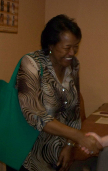 Shirley Woods welcomes the thank you handshake of a participant after the forum.