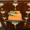 "(06/04/18) A ""Seed Library"" holding various types of seed sit's inside the Leomisnter Public Library on Monday.  SENTINEL & ENTERPRISE JEFF PORTER"