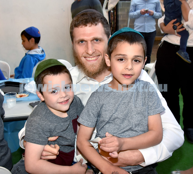 Childrens Succot Rally at Tzemach Tzedek Synagogue. Rabbi Chaim Koncepolski (centre) with his children Zalman (left) and Yitzchak. Pic Noel Kessel