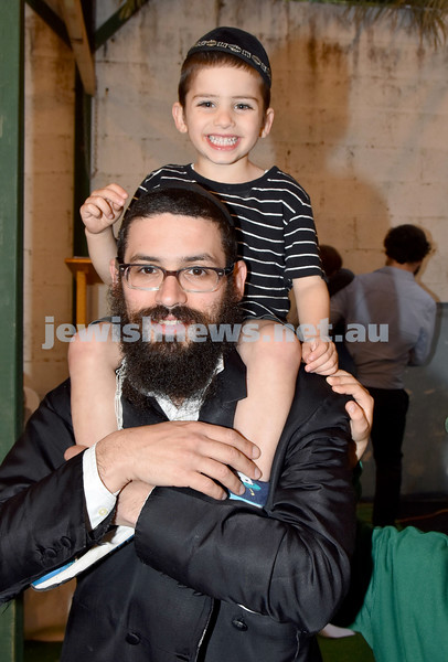 Childrens Succot Rally at Tzemach Tzedek Synagogue. Rabbi Yacov Richter with his son Hirshie. Pic Noel Kessel