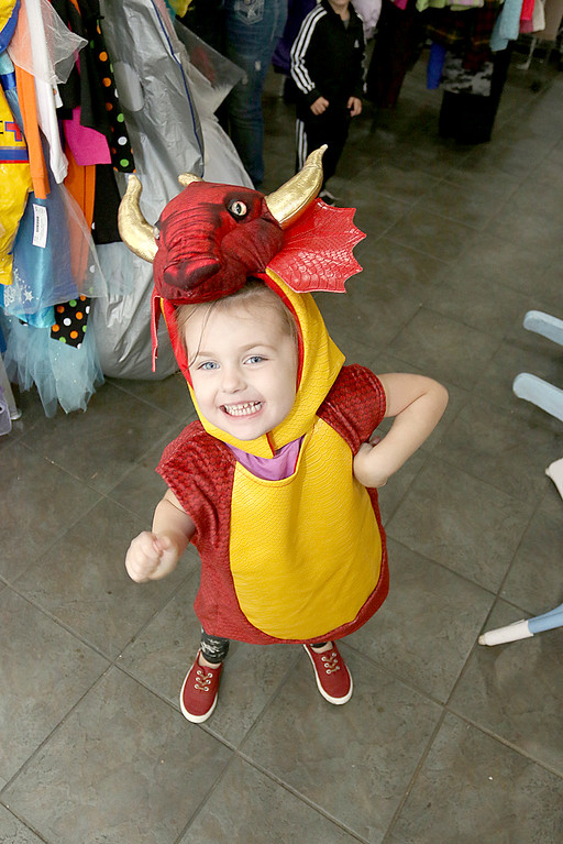 . Children\'s closet, a consignment store for kids has opened this week on Main Street in Fitchburg. Finnely Prescott, 3, put on a dragon costume to run around her mom, Jillianne Prescott\'s, store on Tuesday morning. SENTINEL& ENTERPRISE/JOHN LOVE
