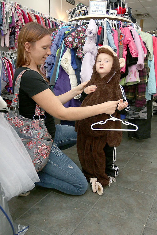 . Children\'s closet, a consignment store for kids has opened this week on Main Street in Fitchburg. Angela Emslie and her son Hunter Emslie, 2, from Ashby stopped into the store on Tuesday morning and found a monkey costume for him to wear for Halloween. SENTINEL& ENTERPRISE/JOHN LOVE