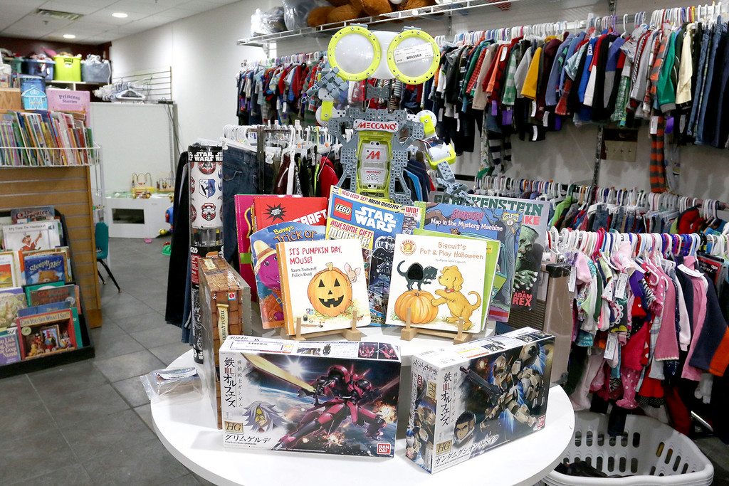. Children\'s closet, a consignment store for kids has opened this week on Main Street in Fitchburg. Disney\'s WALL-E looks over some books at the new store. SENTINEL& ENTERPRISE/JOHN LOVE