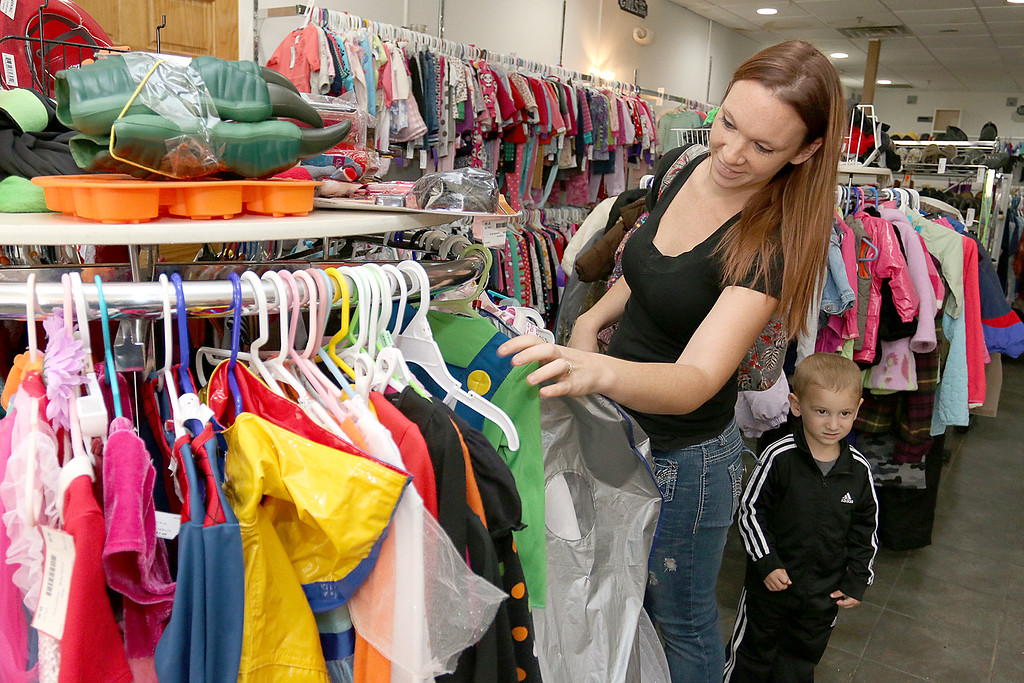 . Children\'s Closet, a consignment store for kids has opened this week on Main Street in Fitchburg. Angela Emslie and her son Hunter Emslie, 2, from Ashby stopped into the store on Tuesday morning to hunt for some new clothes. SENTINEL& ENTERPRISE/JOHN LOVE