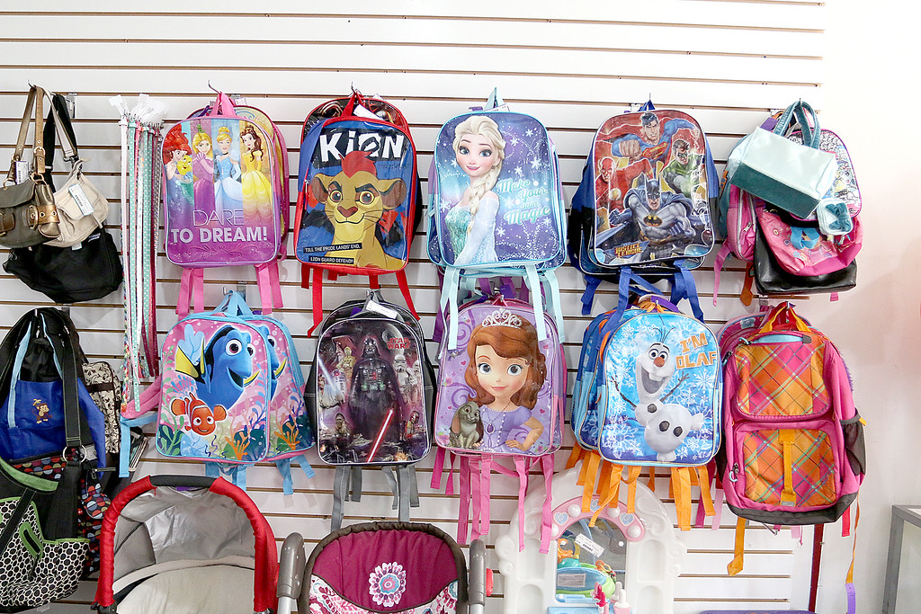 . Children\'s closet, a consignment store for kids has opened this week on Main Street in Fitchburg. They have a wall of backpacks at the new store. SENTINEL& ENTERPRISE/JOHN LOVE
