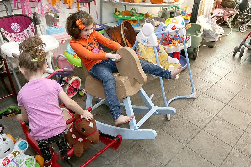 Children's Closet, a consignment store for kids has opened this week on Main Street in Fitchburg. Caddigan Prescott, 5, and her sister Finnley Prescott, 3, play in the store their mom, Jillianne Prescott, owns on Tuesday morning. SENTINEL& ENTERPRISE/JOHN LOVE