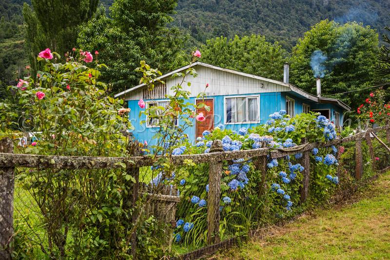 A rural farm home in the Hidden Valley near Puerto Aysen, Chile, South America.