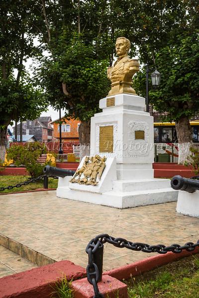 A monument to Jose Galvarino Riveros in the plaza of the village Curaco de Velez, Chile, South America.