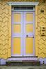 A rustic wooden door in the village of Curaco de Velez, Chile, South America.