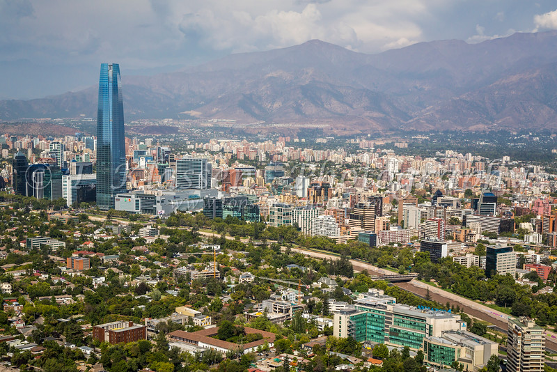 The city skyline with clouds over the Andes Mountains in Santiago, Chile, South America.