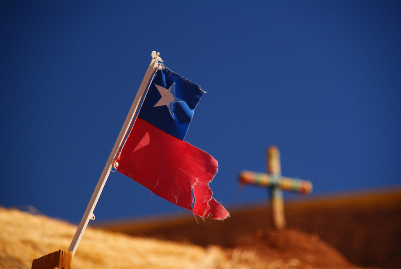"A torn Chilean flag with a Church cross in the background just outside of San Pedro de Atacama - San Pedro de Atacama, Chile.  To purchase this photo click on it or to view the rest of my gallery from San Pedro de Atacama click here. <a href=""http://nomadicsamuel.com"">http://nomadicsamuel.com</a>"