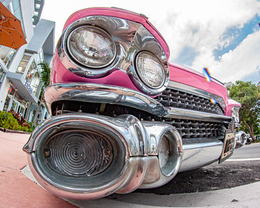 The iconic twin headlights of a 1959 Cadillac.  South Beach, Miami.
