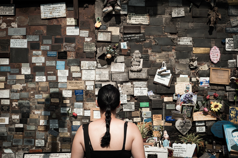 Woman reads the memorials on the wall, Santiago, Chile, South America