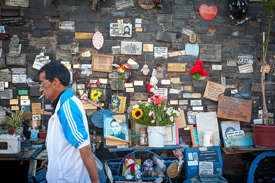 Smoking and walking past a memorial wall, Santiago, Chile, South America