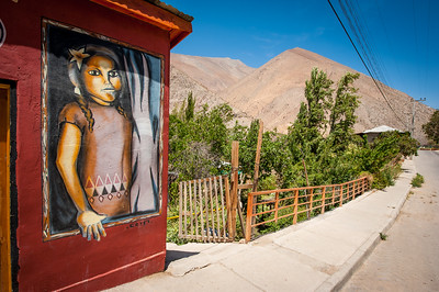 Painting of a young girl on a shop wall, Pisco Elqui, Chile, South America