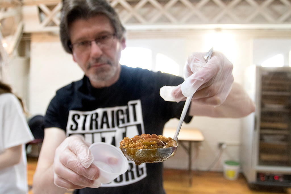 . The Third annual Karing 4 Kidz chili cook-off  was held at the Fitchburg Senior Center Saturday, May 4, 2019. Gary Therrien, a volunteer at the cook-off, at shows off a spoon full off one of the celebrity entries. SENTINEL & ENTERPRISE/JOHN LOVE