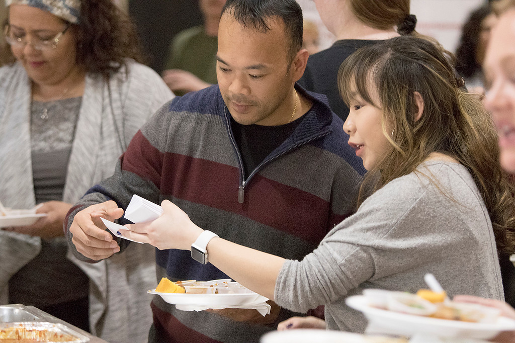 . The Third annual Karing 4 Kidz chili cook-off  was held at the Fitchburg Senior Center Saturday, May 4, 2019. Kira Andreucci the founder of Karing 4 Kidz explains the voting to State Senator Dean Tran during the event. SENTINEL & ENTERPRISE/JOHN LOVE